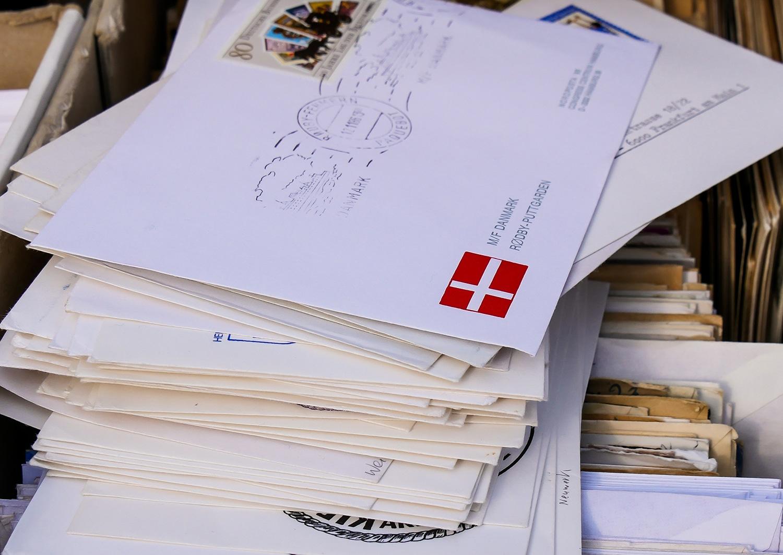 Postando vs. Herkömmliche Postkarte