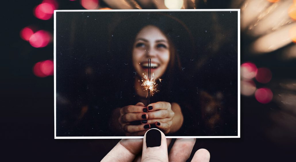 New Year card Laughing woman holding sparkler