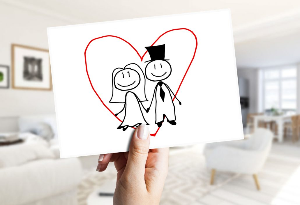 Invitation card with a wedding couple as a minimalist caricature
