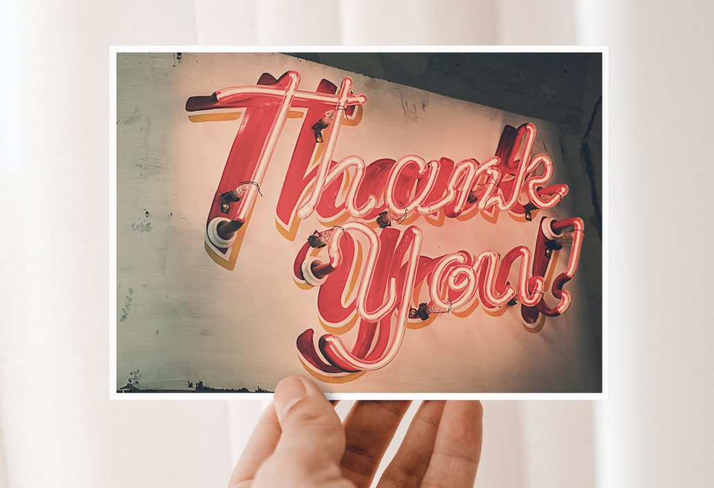 Thank you cards with Thank You lettering made of neon tubes